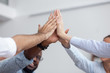 Leinwandbild Motiv Multi ethnic business team give high five together, close up