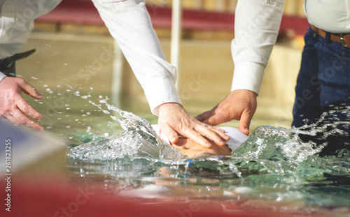 Photographie Close up of pastors hands who baptize man