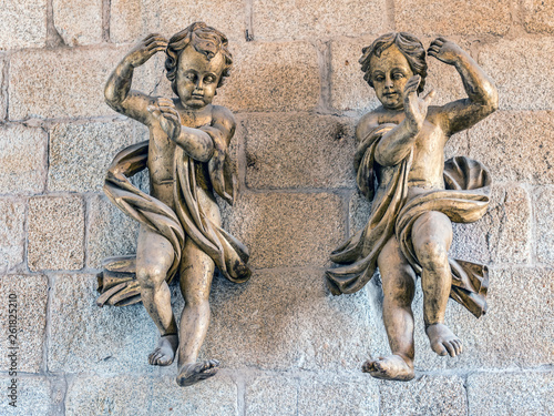 Two cherubs in Romanesque Cathedral of Porto, Portugal Canvas Print