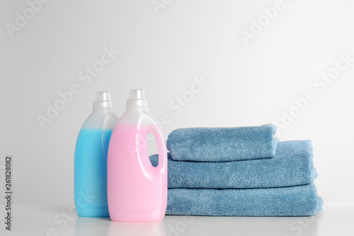 Garden Poster Spa Detergents and clean towels on white background. Laundry day