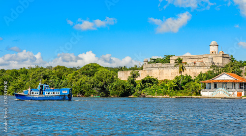 Jagua castle fortified walls with trees and fishing boats in the foreground, Cie Canvas Print