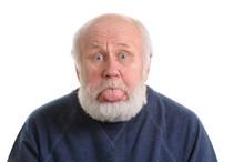 Senior Man With Sticking Tongu...