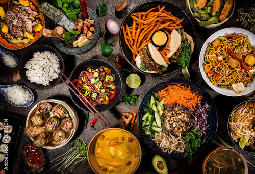 Valokuva  Asian food background with various ingredients on rustic stone background , top view