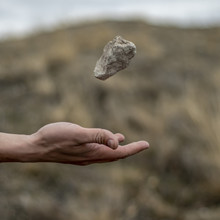 Stone Hovering Above Hand