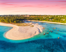 Aerial View Of The Fishing Boats On Tropical Sea Coast With Sandy Beach At Sunset. Summer Holiday. Indian Ocean, Zanzibar, Africa. Landscape With Boat, Green Trees, Blue Water, Colorful Sky. Top View