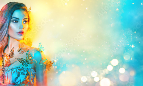 Foto op Canvas Beauty Beauty fantasy model spring girl in colorful bright neon lights. Portrait of beautiful summer young woman in UV. Art design colorful make up with golden butterflies. On colourful vivid background