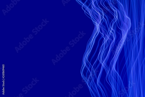Photographie  Blue light painting photography, long exposure waves and curves against a blue b