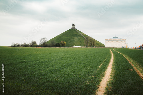 Valokuvatapetti Famous Lion's Mound memorial site at the battlefield of Waterloo with dark cloud