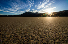 The Dry Desert Of California Death Valley Floor Playa Is A Desolate Place. This Area Makes One Feel Exiled From Reality And Gives An Emotion Of Lifelessness. Captured During Sunrise In The Summer