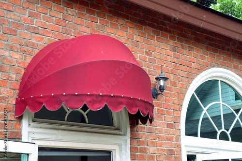 Fotografie, Obraz  Red awning front store building