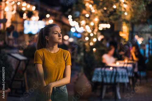 Photo  Street scene with young woman in evening in Tbilisi, Georgia