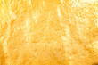 Shiny gold paint on concrete wall texture for background