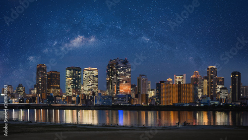 Foto op Aluminium Buffel Osaka city view in Kansai, Japan at night with starry sky. Panoramic city background