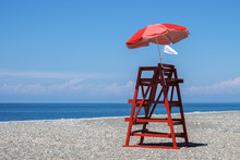 Red Rescue Tower And Beach Umb...