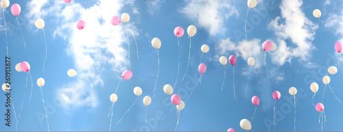 Fotografie, Obraz  Colorful bouncing balls outdoors against blue sunny sky. Banner
