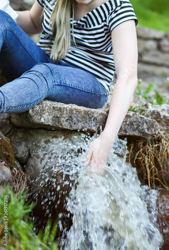 Woman hands in cold transparent water stream in supring park Canvas-taulu