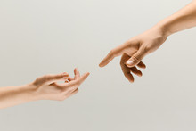 Moment Of Weightless. Two Male Hands Trying To Touch Like A Creation Of Adam Sign Isolated On Grey Studio Background. Concept Of Human Relation, Community, Togetherness, Symbolism, Culture And History