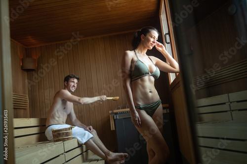 Foto op Plexiglas Artist KB Young happy couple relaxing inside a sauna at spa resort hotel luxury