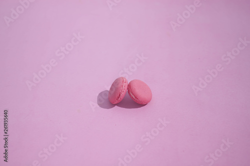 Foto op Canvas Macarons Macaroons on a colored background, picture of colorful french macarons cookies. Macaron French pastry on a pink background, minimal concept.