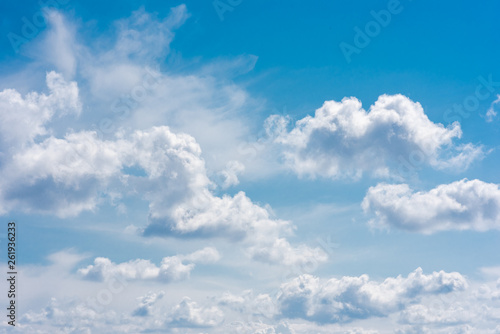 obraz lub plakat Beautiful white cumulonimbus clouds against the background of the bright blue sky