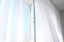 Open Window With Light Curtains In Room