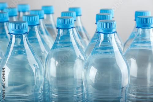 Fototapeta  Bottles of water on light background