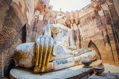 Fotografie, Obraz Ancient big buddha statue inside Wat Si Chum temple in Sukhothai, Thailand