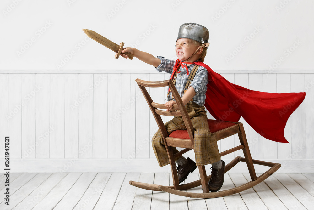 Fototapeta Little boy plays the knight