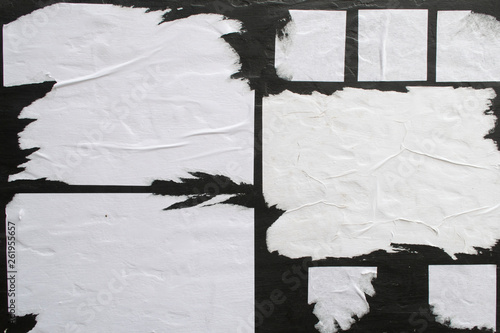 Tablou Canvas Several sheets of white paper pasted on a black wall.