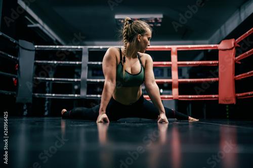 Fotografía Beautiful caucasian boxer girl doing exercises on ring floor.
