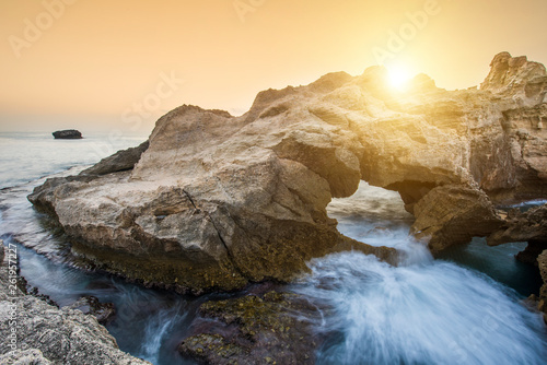 Sunset over rocky coast in Calabria