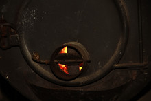 Fire In A Large Iron, Black Stove