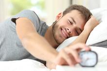 Happy Man Waking Up Turning Off Alarm Clock