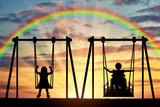 Fototapeta Tęcza - Happy child is a disabled person in a wheelchair riding an adaptive swing next to a healthy child together