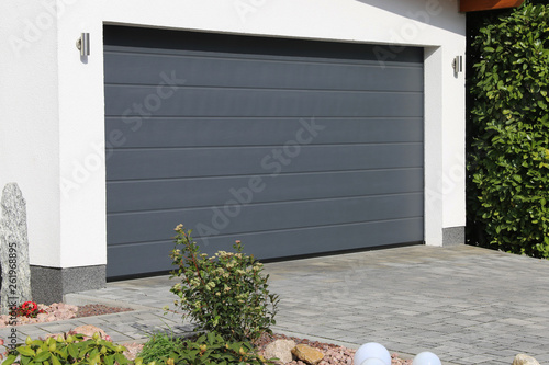 Fototapeta Modern new garage door (sectional door)