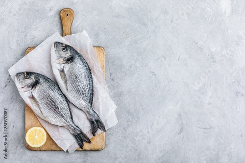 Fototapeta Fresh raw dorado fish with spices