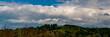 Leinwandbild Motiv landscape with clouds in hilly terrain on a sunny day.Web banner.