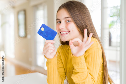 Beautiful Young Girl Kid Holding Credit Card Doing Ok Sign With
