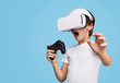 canvas print picture Amazed kid in VR glasses playing game