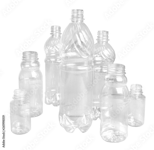 Fotografie, Obraz  Several plastic bottles of different sizes and for different purposes on a white isolated background