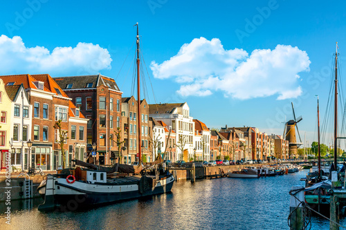 Spoed Fotobehang Rotterdam Old historic district Delfshaven with wildmill and houseboats in Rotterdam, South Holland, The Netherlands. Summer sunny day.