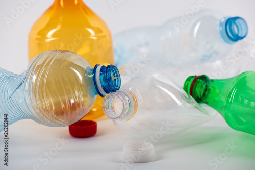 Photo  Clear water bottles lying together and being crumpled