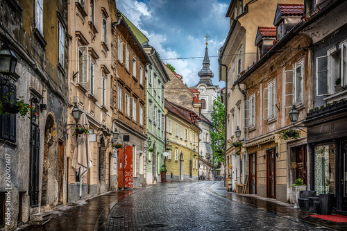 Leinwand Poster  Street of the old city Ljubljana after the rain