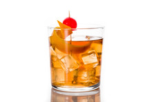 Old Fashioned Cocktail With Orange And Cherry Isolated On White Background