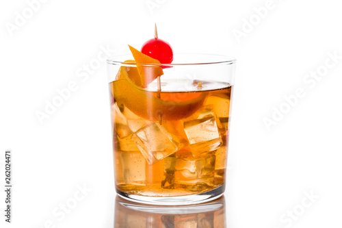 Obraz Old fashioned cocktail with orange and cherry isolated on white background - fototapety do salonu