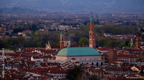 wide panorama during the sunset of the city of Vicenza and the famous monument called Basilica Palladiana with the tall Clock Tower. Vicenza, Veneto, Italy - April 2019