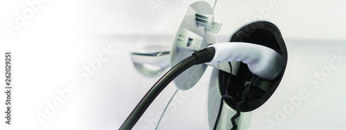 Fotografia Electric car charging on charge station, Transport which are the future of the a