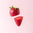 Leinwanddruck Bild - Sliced strawberry on pastel pink background. Minimal fruit concept.