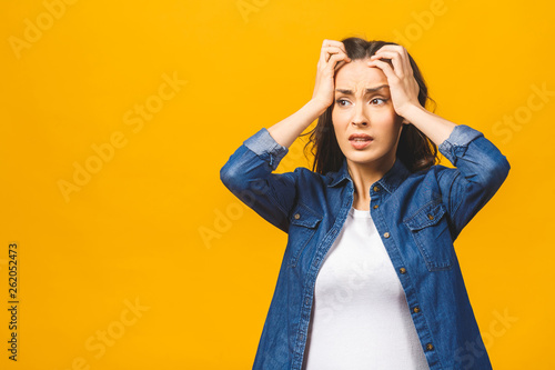 Fotografia Young beautiful woman over isolated background suffering from headache desperate and stressed because pain and migraine