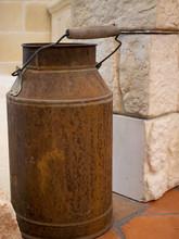 Closeup Old Vintage Rusty Milk Can Tank At Farm